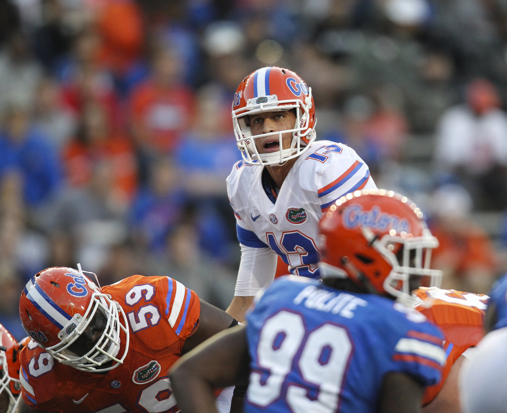 Quarterback Feleipe Franks (13) calls plays during the first quarter of the Orange and Blue Debut at Ben Hill Griffin Stadium in Gainesville, Fla.