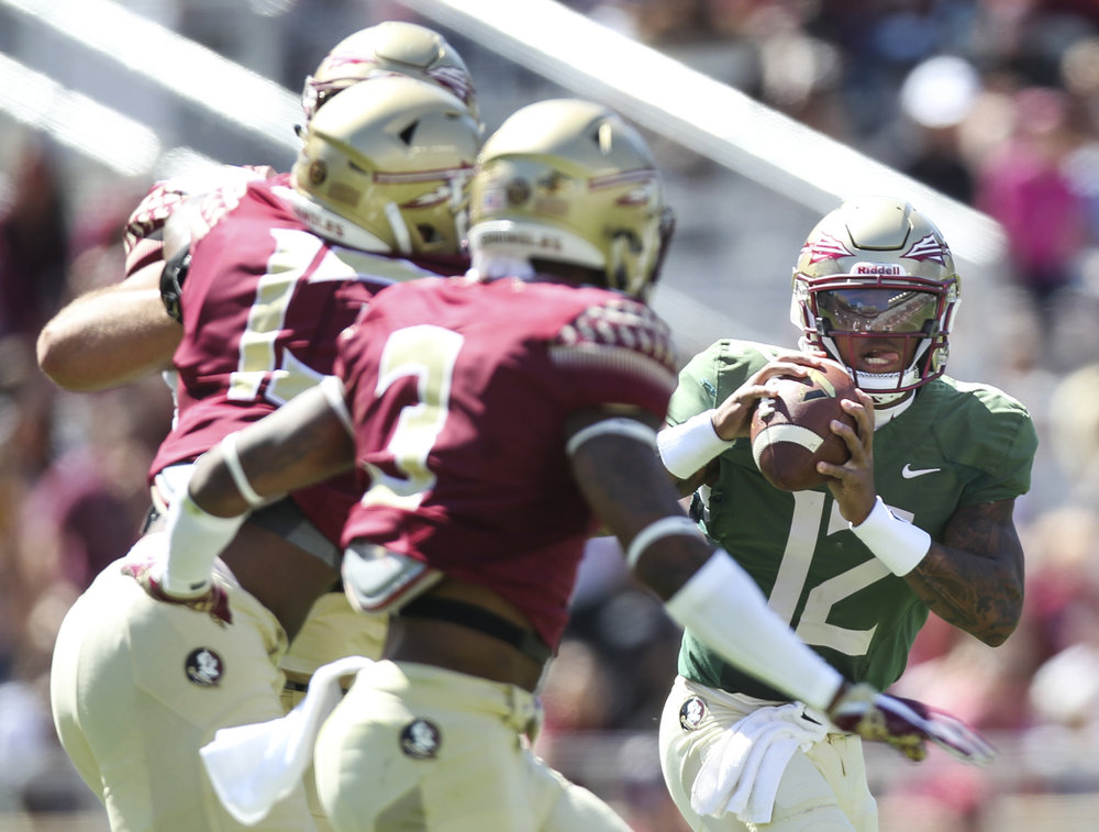 Florida State Seminoles quarterback Deondre Francois (12) looks for a receiver during the first half of the Garnet and Gold spring game at Doak Campbell Stadium in Tallahassee, Florida on Saturday April 8, 2017.