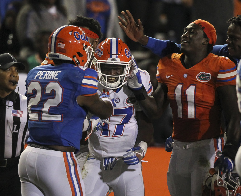 Quarterback Kadarius Toney (17) celebrates a long carry at the conclusion of the fourth quarter of the Orange and Blue Debut at Ben Hill Griffin Stadium in Gainesville, Fla.