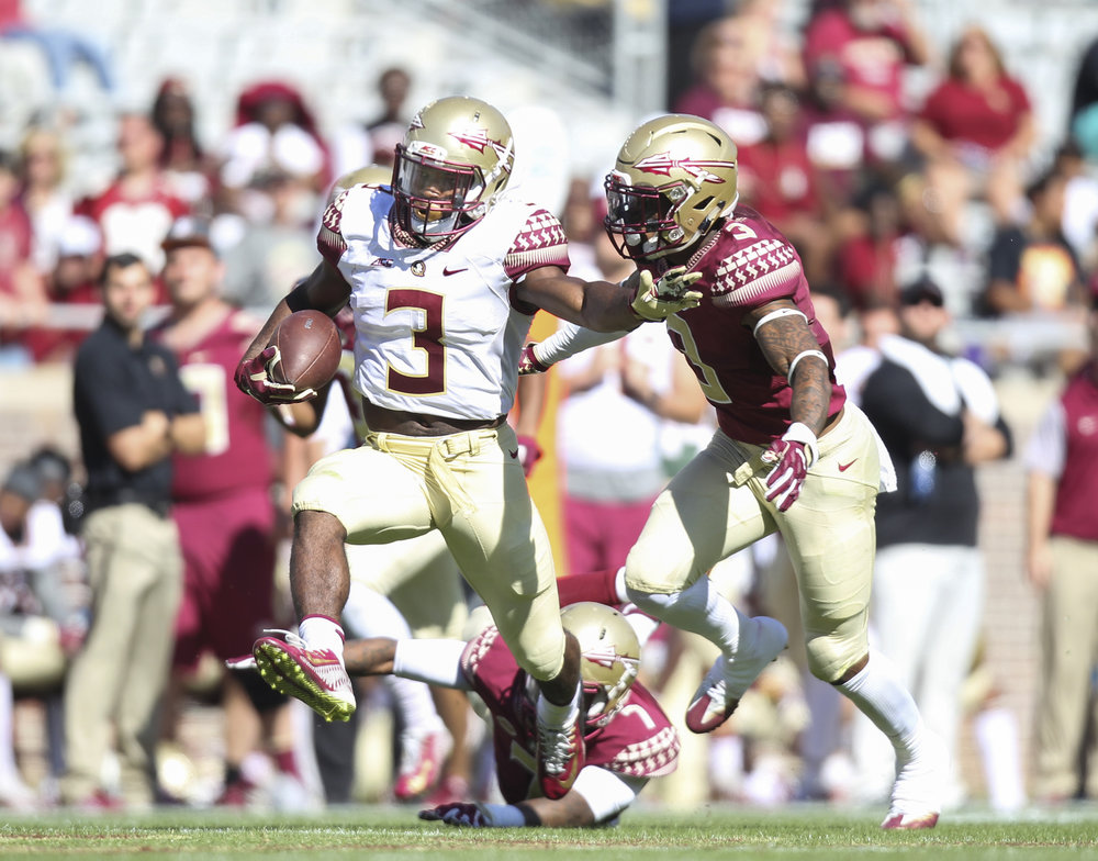 Florida State Seminoles Cameron Akers (3) gets stopped by Derwin James (3) during the second half of the Garnet and Gold spring game at Doak Campbell Stadium in Tallahassee, Florida on Saturday April 8, 2017.