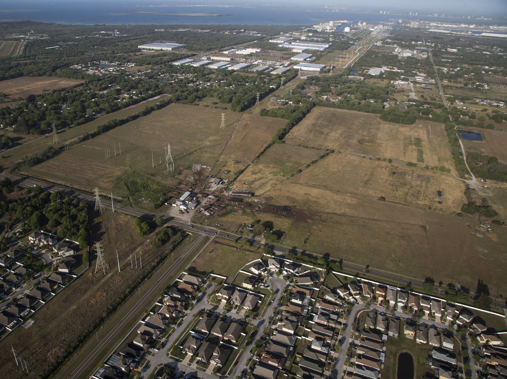 "The nearly 250 acres of Busciglio family farm land, as seen from the air on March 24, 2017. Tower Dairy is less than 10 miles from downtown Tampa and the last dairy farm in Hillsborough County, Florida. Although the farm used to be at the end of a dirt road, development has closed in on the property. ""They offered them so much money they couldn't afford not to sell it, "" Sammy Busciglio said."