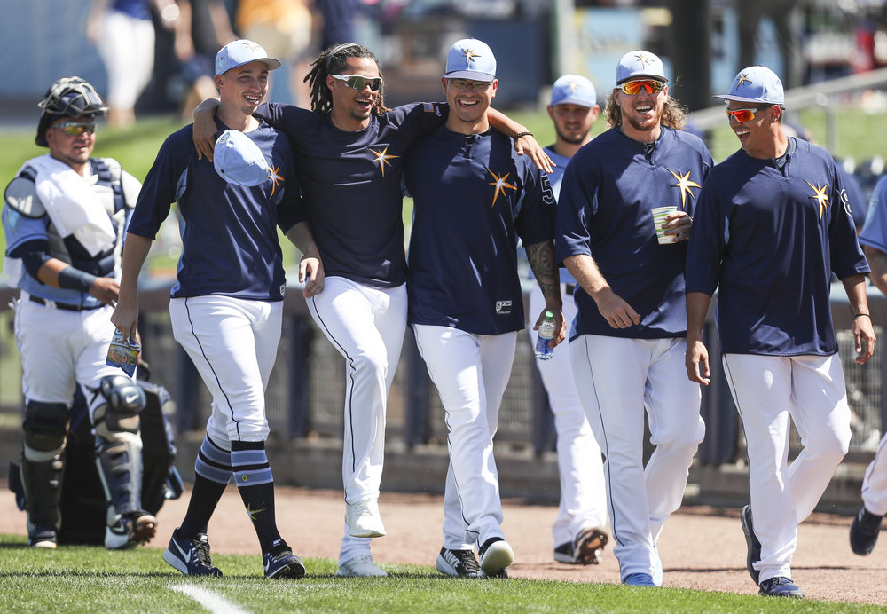 MONICA HERNDON   |   TimesBlake Snell (4), Chris Archer (22) and teammates walk out for the Tampa Bay Rays spring training game against the Baltimore Orioles on March 1, 2018 at Charlotte Sports Park in Port Charlotte, Fla. The Rays lost to the Orioles, 2 to 5.