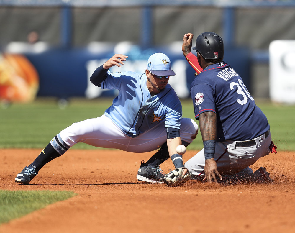 MONICA HERNDON   |   TimesWilly Adames (1) of the Tampa Bay Rays is unsuccessful in tagging Kenny Vargas (30) of the Minnesota Twins, out during the fourth inning against the Minnesota Twins on March 9, 2018 at Charlotte Sports Park in Port Charlotte, Fla.