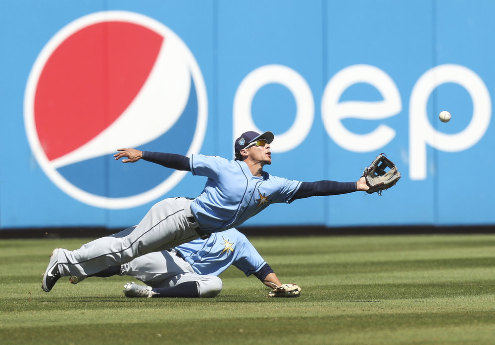 MONICA HERNDON   |   TimesAndrew Velazquez (77) of the Tampa Bay Rays can't get to the single by Gregory Polanco (25) of the Pittsburgh Pirates, during the third inning of a spring training game against the Pittsburgh Pirates at LECOM Park in Bradenton, Fla.
