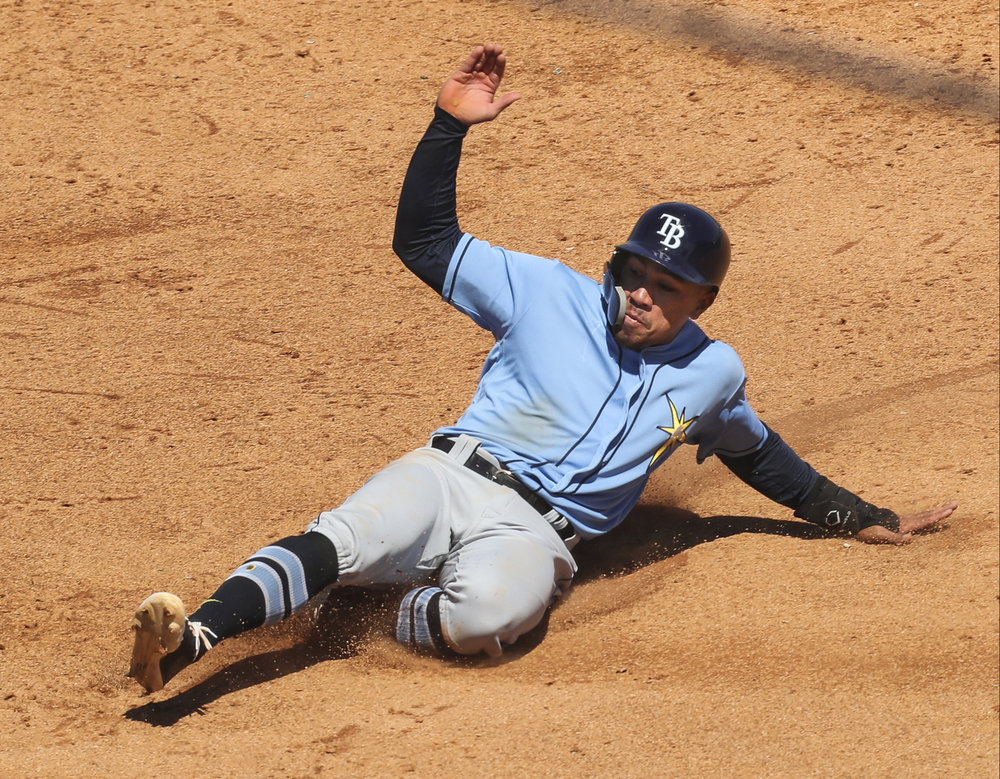 MONICA HERNDON   |   TimesKean Wong (73) of the Tampa Bay Rays steals a base in the sixth inning of a spring training game against the Pittsburgh Pirates at LECOM Park in Bradenton, Fla.