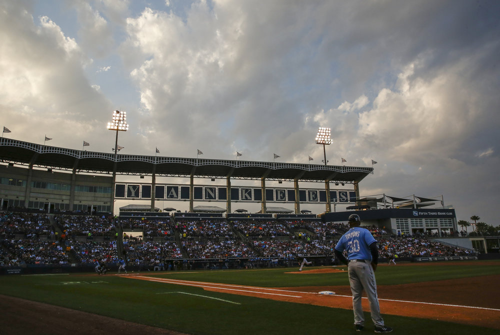 MONICA HERNDON   |   TimesThe sun sets during the Tampa Bay Rays spring training game against the Yankees on March 19, 2018, at Steinbrenner Field in Tampa, Fla.