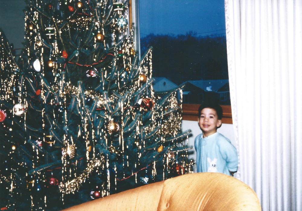 me at 2 years old... probably hoping that santa brought Crayola crayons!