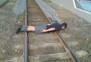 Reid Moodie posted this photo on Facebook of him planking on The Strand, shocking his step-mother Vanessa.