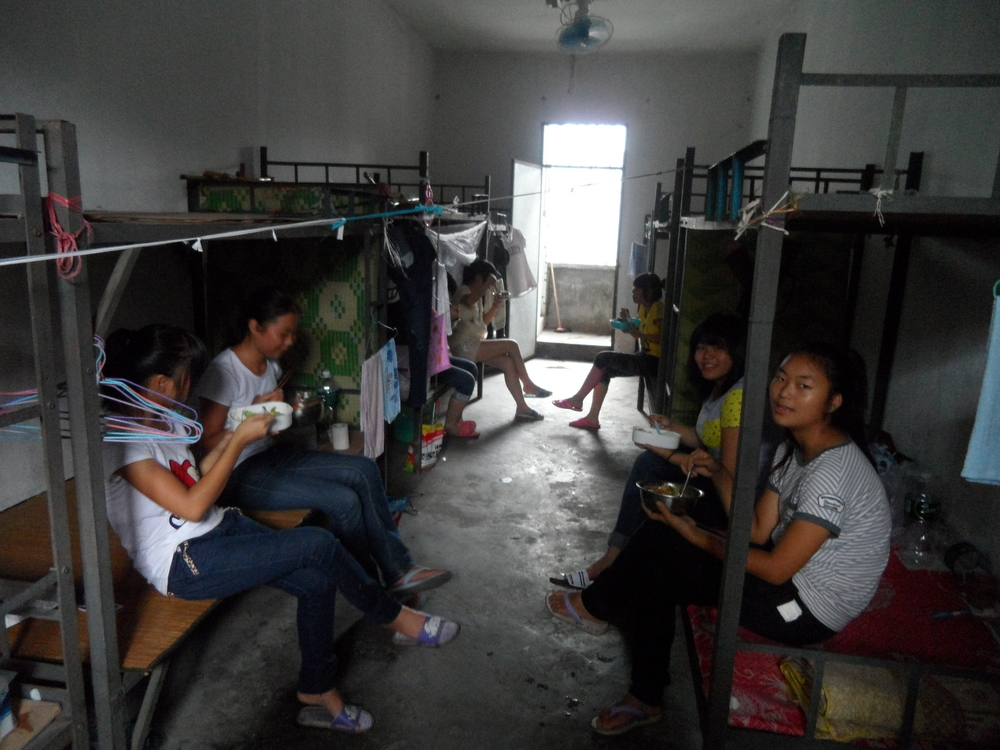 Female factory workers eating lunch in their rooms