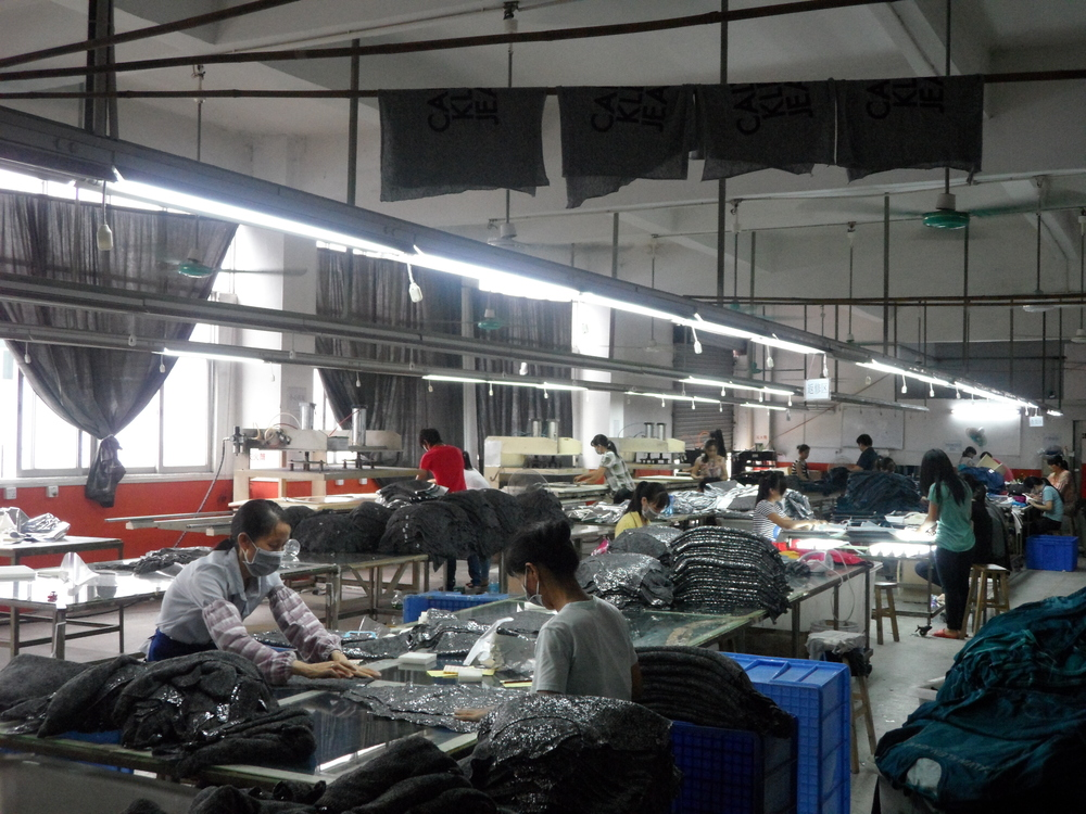 Workers doing various tasks on one floor of the factory