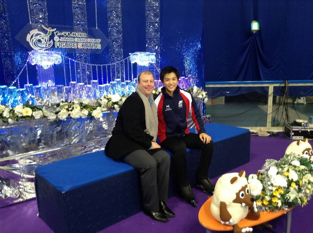 With my coach, Justin Dillon, in the kiss and cry after my short program