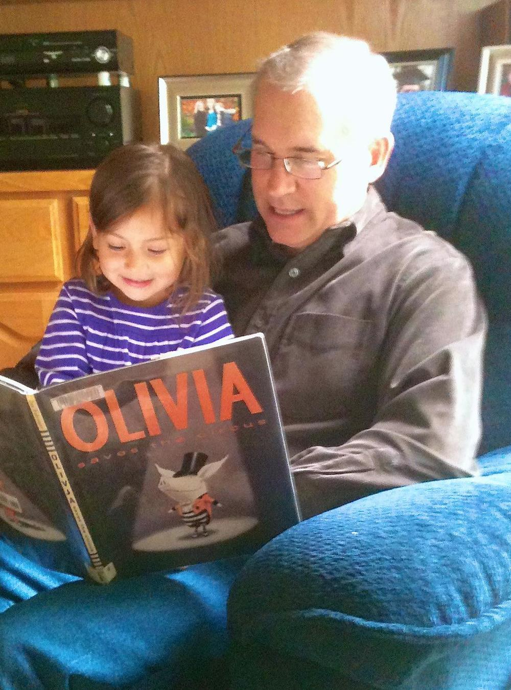Grandpa granddaughter reading together.jpg
