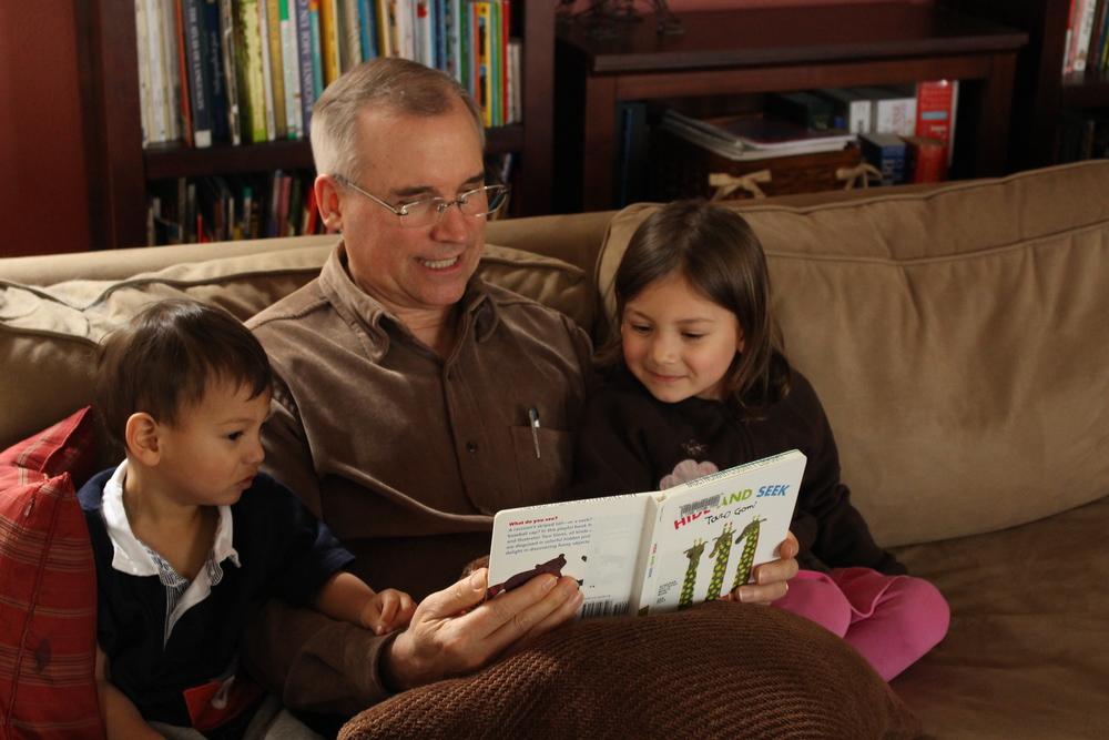 My dad reading to my children