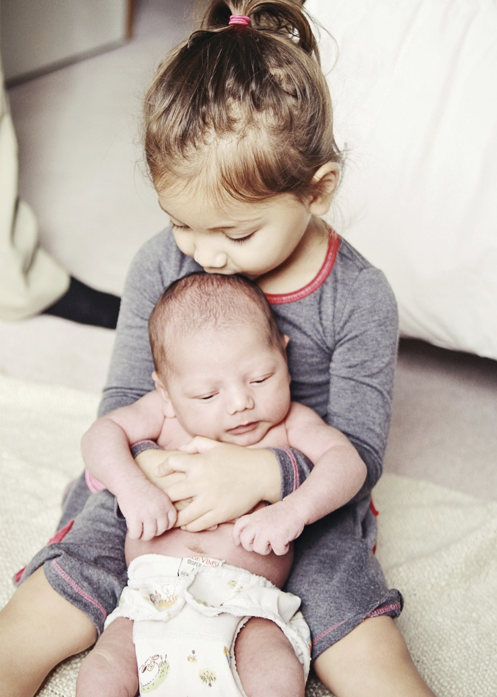 Our two-year-old daughter with her two-week-old baby brother; photo by Shayne Berry of  Catchlights Photography