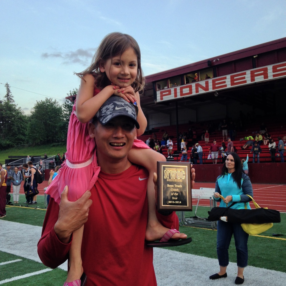 My husband and daughter with this year's conference coaching award