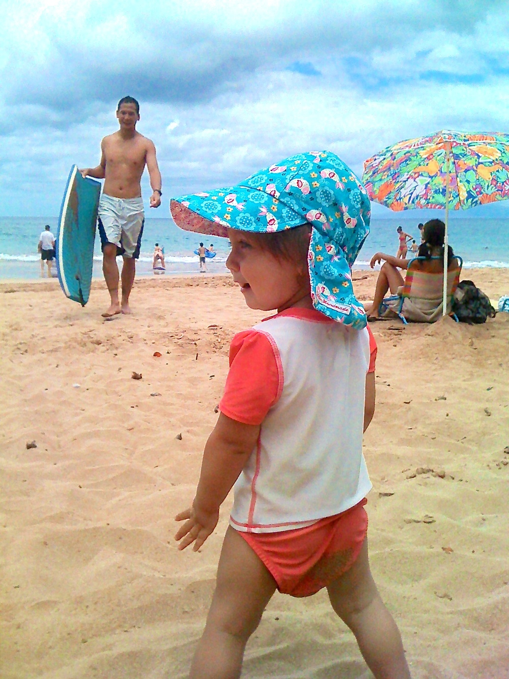 My husband and daughter on a Maui beach in 2010