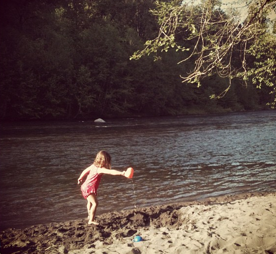 Our daughter playing along the Sandy River in Oregon