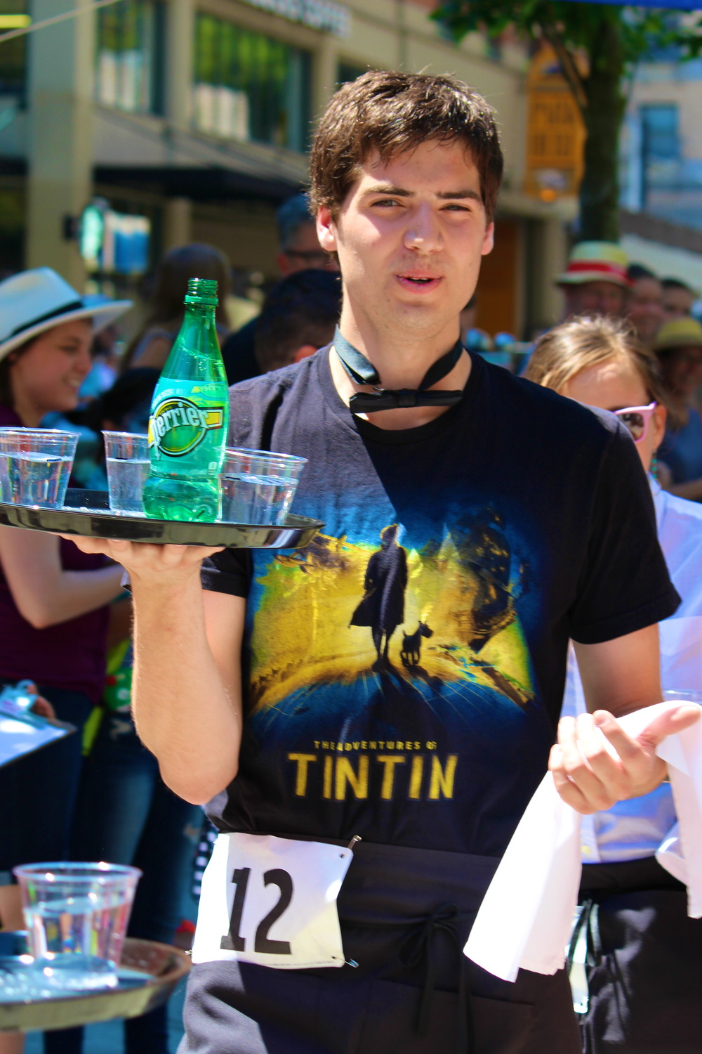 Thomas Geulin left his post at the St. Honoré booth to participate in the waiter's race