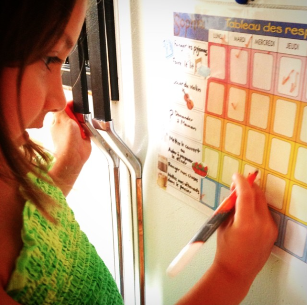 My daughter checking off her chore chart (photo from  my Instagram account )