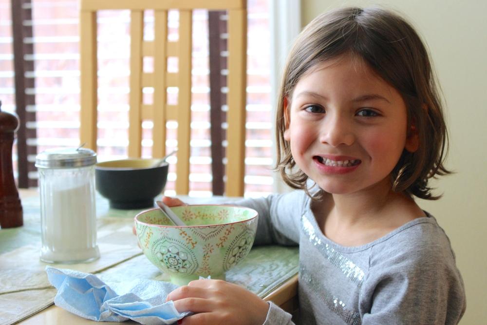 My daughter enjoying her grandma's khao soi soup for breakfast