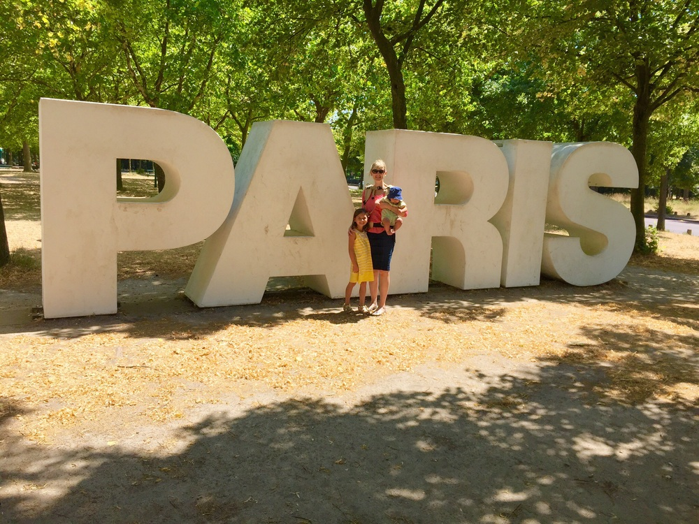 Two of my children with me outside the Parc Floral, Paris