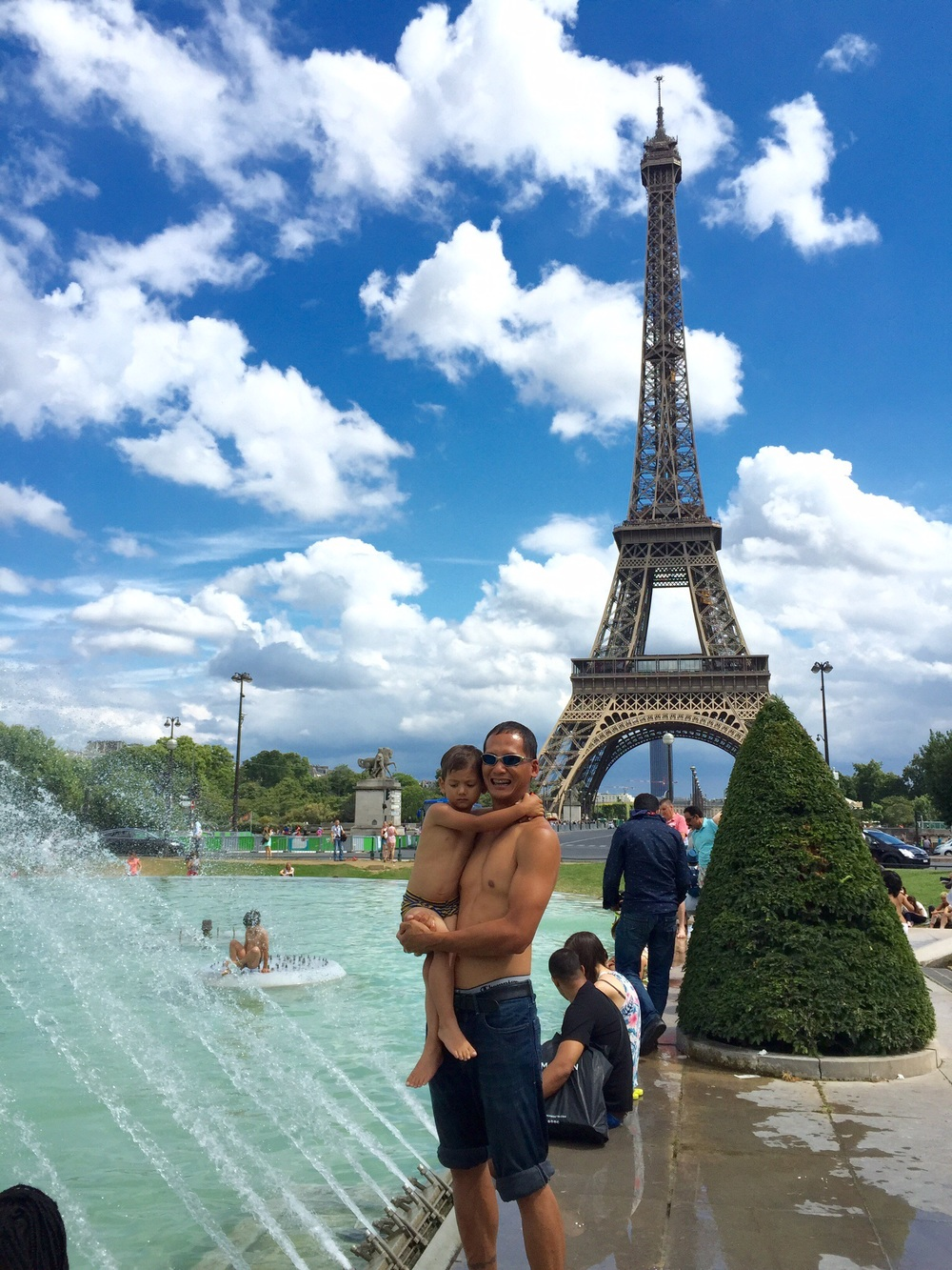 My husband and son at the Trocadero fountain and Eiffel Tower