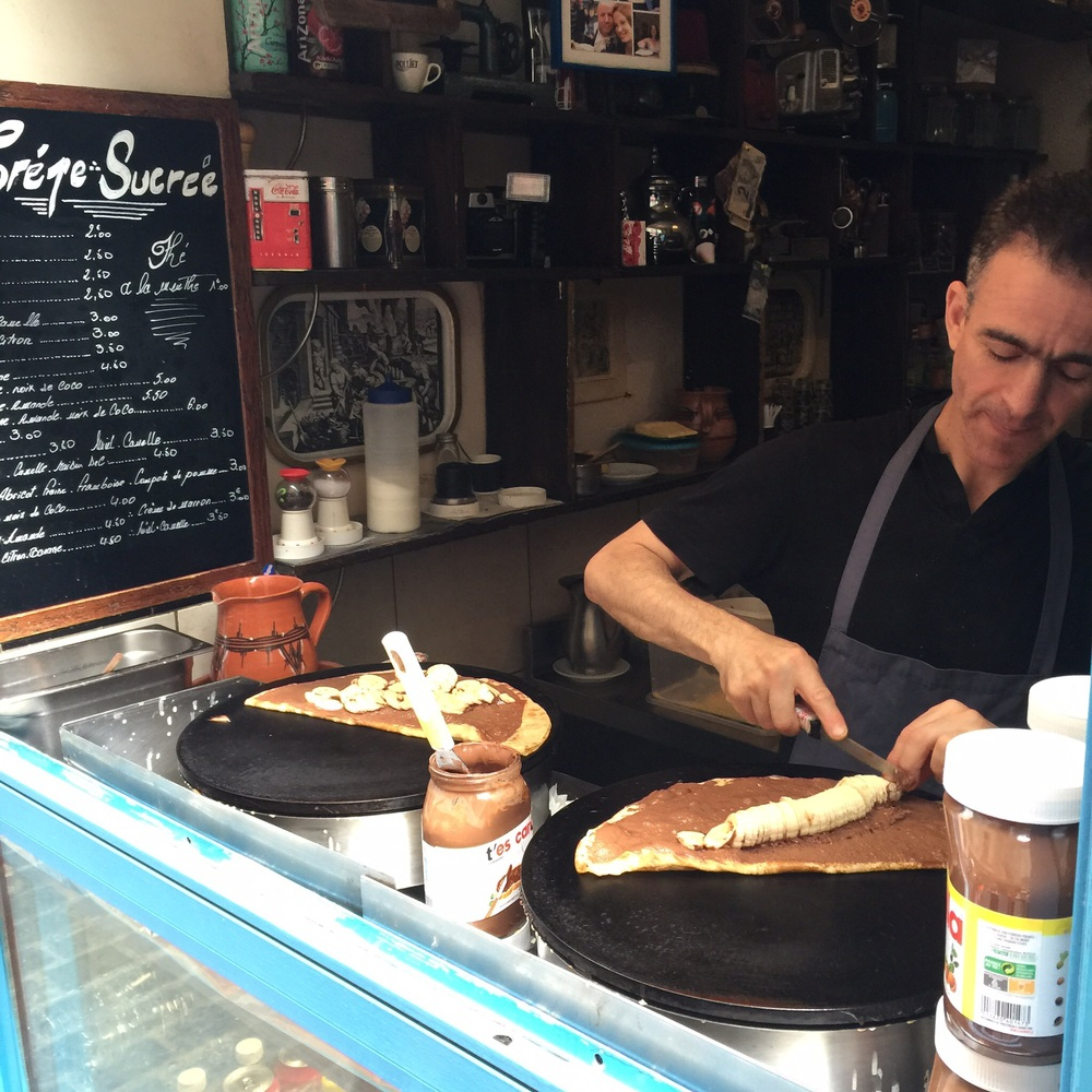This man makes over 400 crêpes each day--and they're all delicious (like this Nutella Banana combination that my daughter ordered)