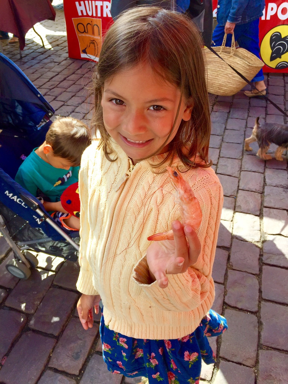 A seafood seller at the market gave my daughter a  crevette --it was delicious! (She didn't want to eat it, so I did.)