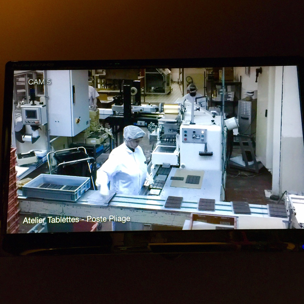 A chocolate factory employee as seen on the webcam