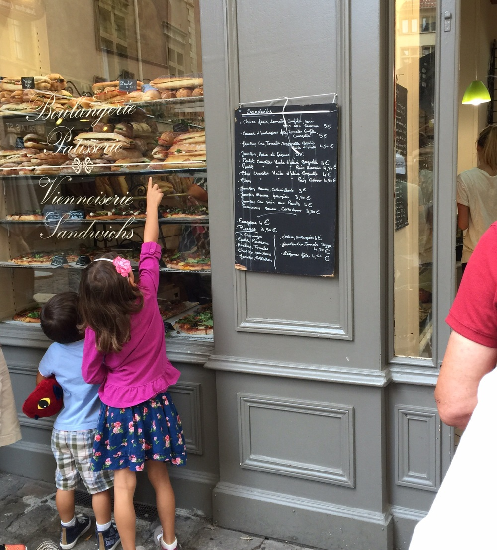 My children picking out a sandwich at a boulangerie --we ate lunches out fairly often before we settled in to our apartment in Lyon