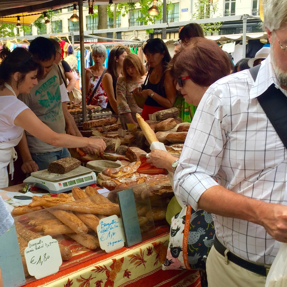 Bread and buyers at the open air market near Place de la Bastille, Paris