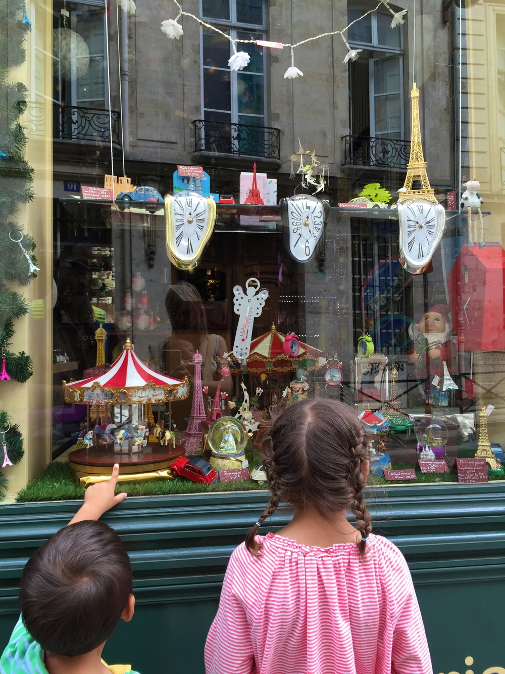 My children admiring the window displays in Paris