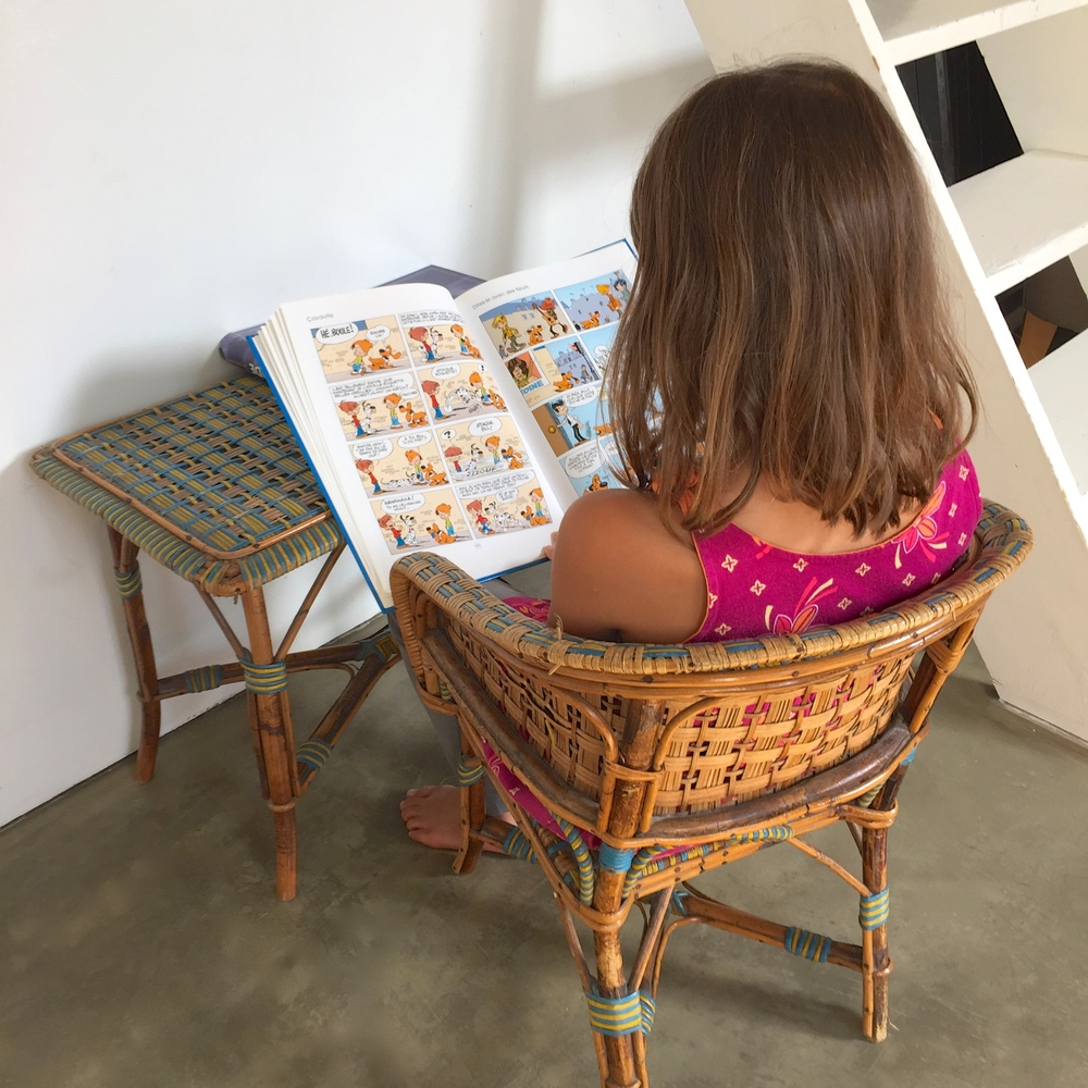 My daughter enjoying  Boule and Bill  comics in the Paris Airbnb apartment we rented