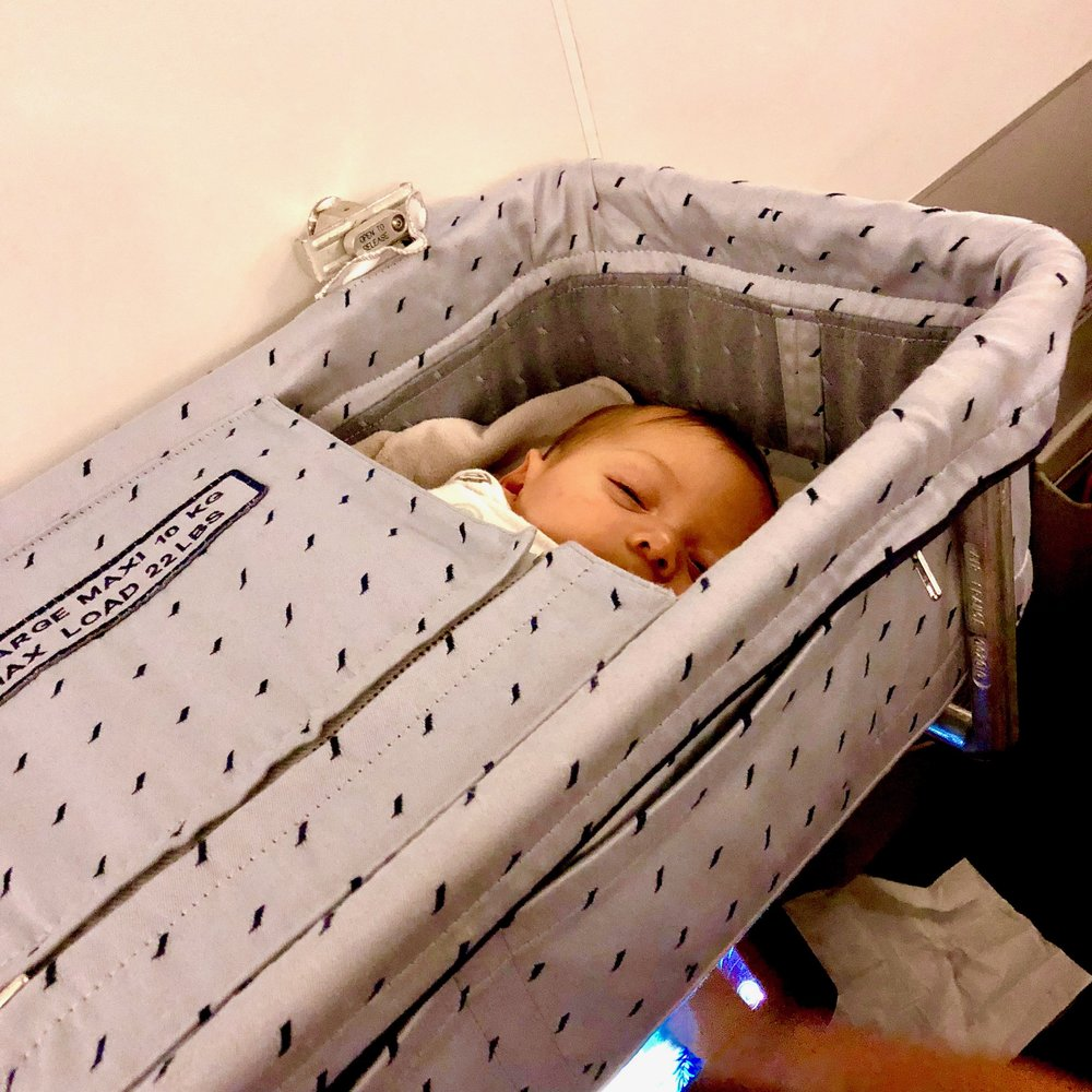 My four month old asleep in the Air France bassinet