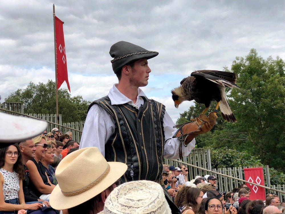 A falconry trainer in le Bal des Oiseaux Fantômes, August 2018
