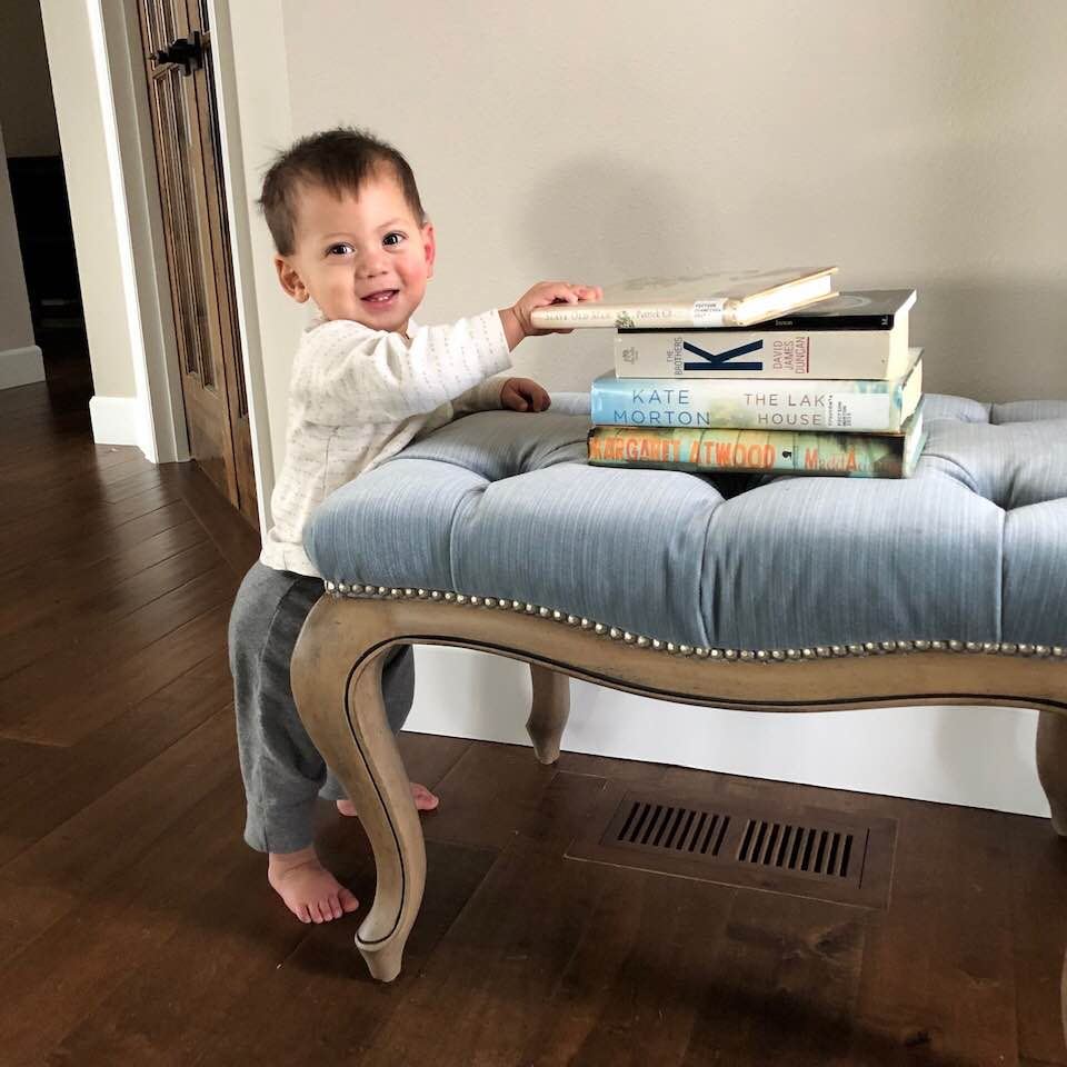 Our youngest son taking delight in mama's books
