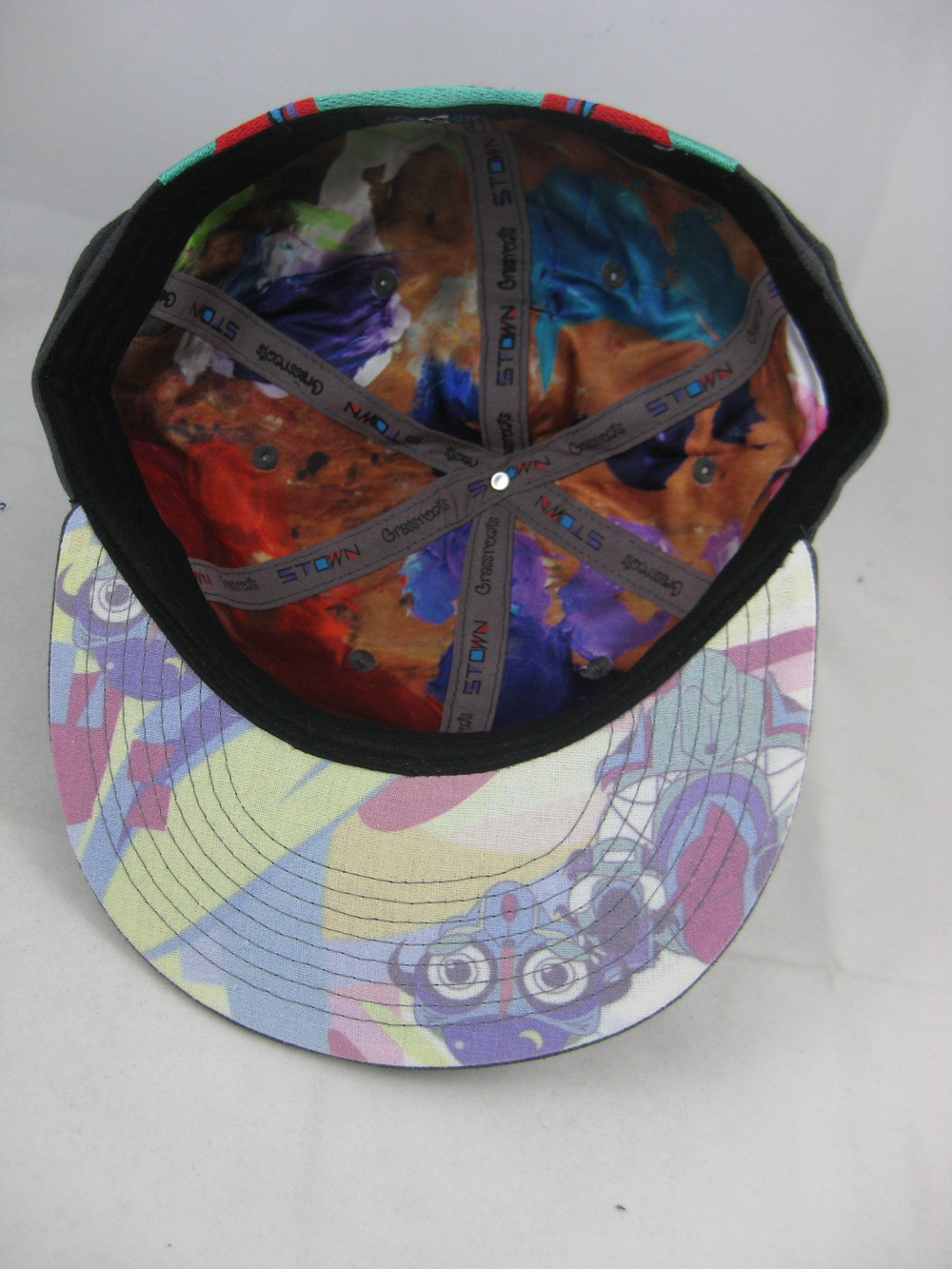 All four hats have satin lining featuring a picture of Spencer Tyler's pallet of colors he paints with as the inner graphic. The under-brim has a soft pastel colored look that complements this unique fitted.