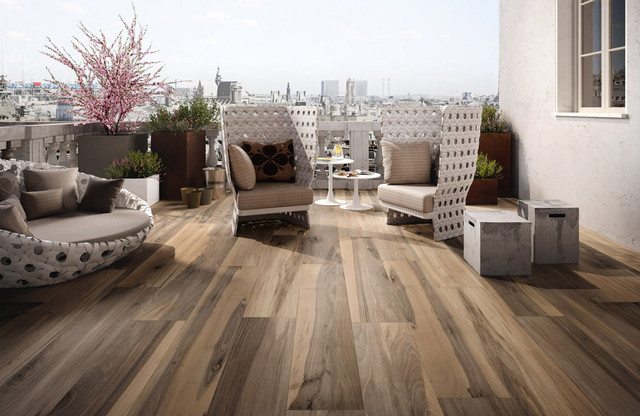 A gorgeous linear large format wood-look porcelain above and a stunning slate-look multi-size porcelain below, both courtesy of google images.