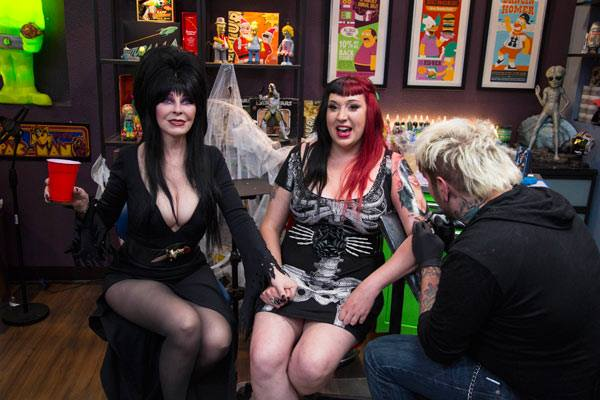 Editor-in-Chief of Living Dead Magazine getting Elvira's portrait tattooed on her arm.