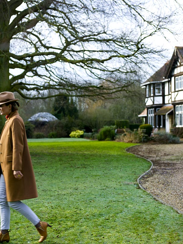 Set amidst three acres of Chilterns land, the mock Tudor-style exterior of the house.