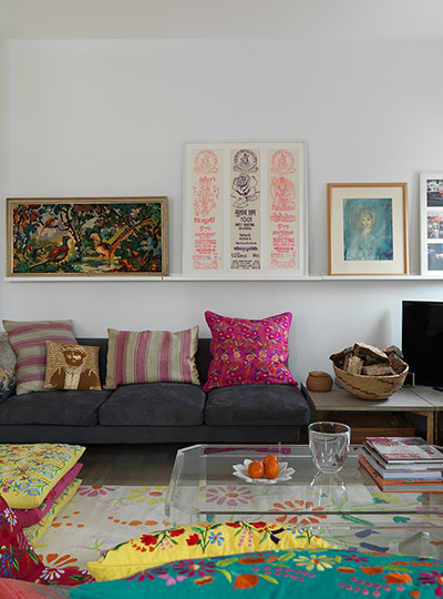 The homeowners use this space to display objects that inspire them, including fabrics from India and pictures picked up at antique fairs. On the sofa are a mix of cushions from The Cross (thecrossshop.co.uk) and Lulu & Nat. 'When I first started sourcing cotton for Lulu & Nat, we visited the local Mumbai fabric markets', explains Lulu