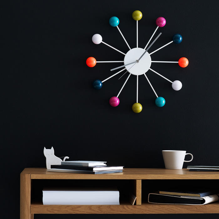 Perfect for bringing life to an empty wall, this multi-coloured clock looks striking against black.