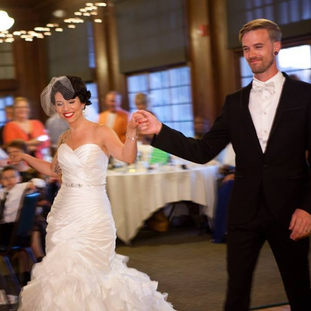 Amber and Ashton wowing their guests at their wedding. Photo by eight one seven photography.