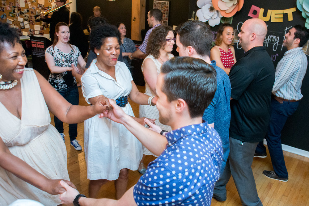 Guests learning to swing and meeting new people at a party.