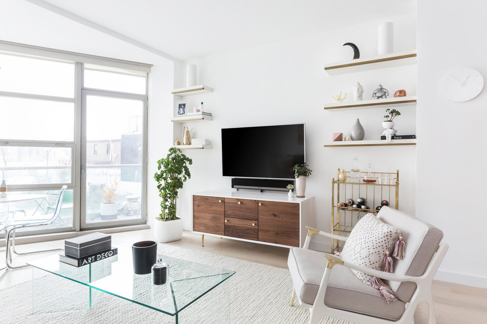 an-nyc-rental-that-looks-straight-out-of-la-floating-shelves-tv-stand-apartment-5a6fa2e2604f27084a0d4a88-w1000_h1000.jpg