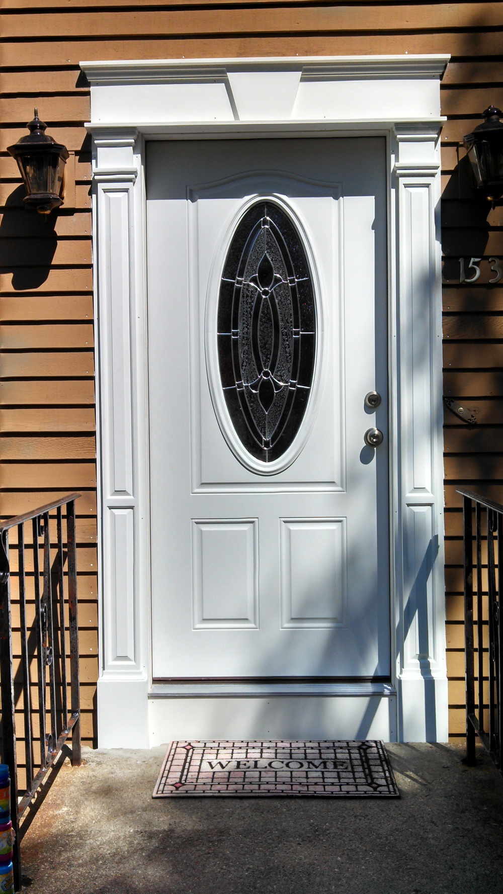 Fiberglass entry door with Fypon columns and custom PVC header