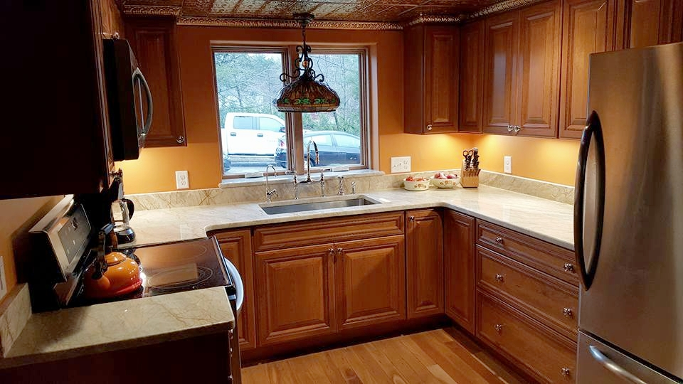 Kitchen Remodel: From a small (10x10)cabin style kitchen to a warm modern kitchen. Complete with new granite counter-tops, tin copper ceiling & crown molding, New sink, appliances, cabinets, integrity window, and bumped out window with granite sill. All new electrical also done.