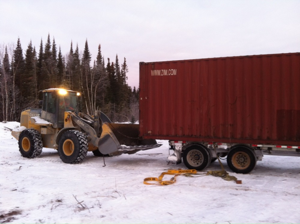 Unloading the containers on the future farm site.