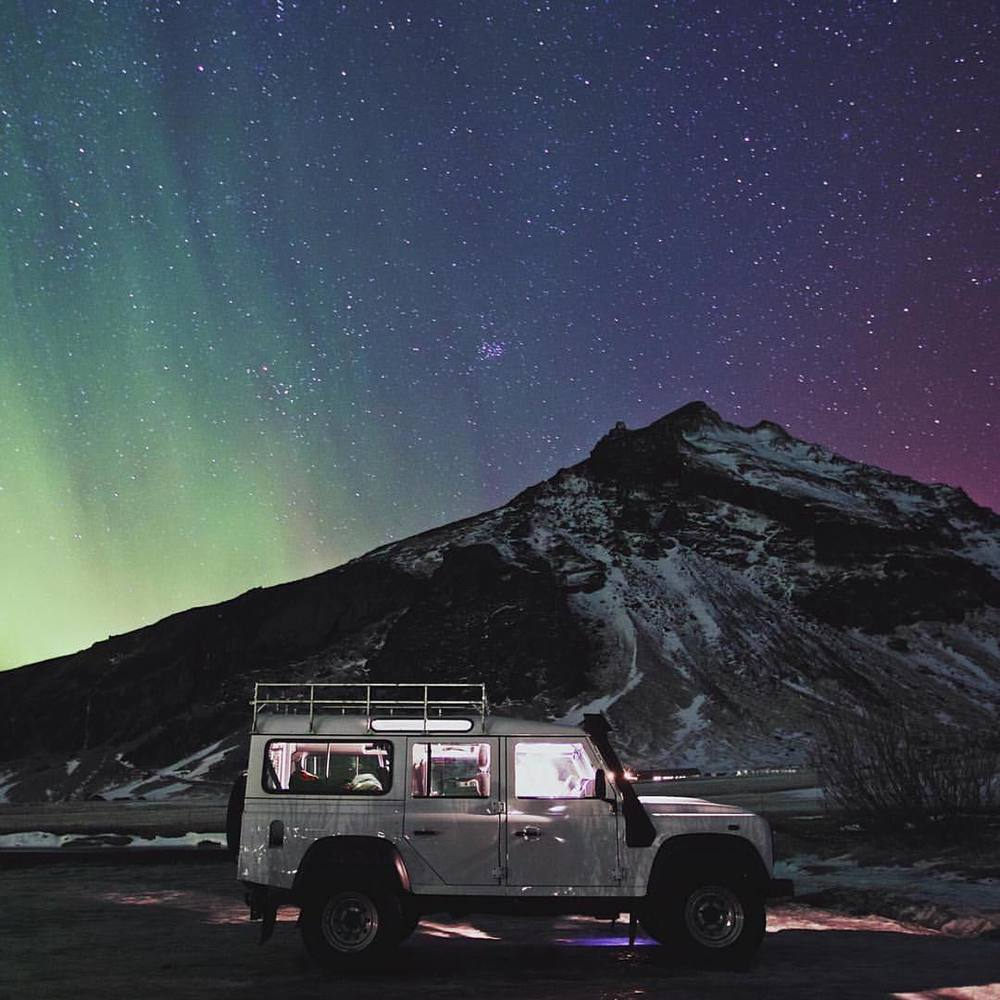 upknorth :     Aurora hues.                          #getoutdoors #upknorth  Land Rover Defender in its element. Northern lights in Iceland shot by @jarradseng  (at Iceland)
