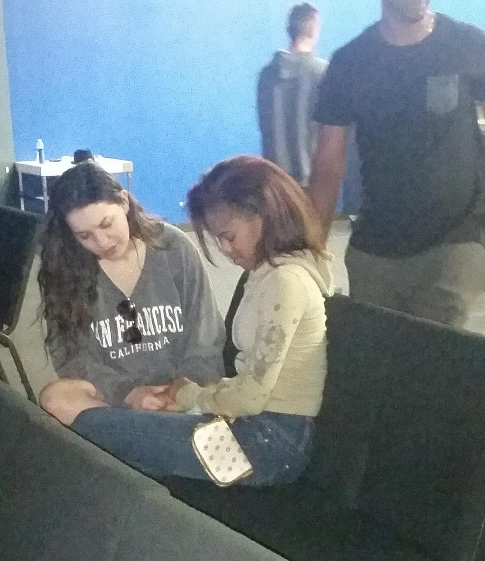 Tarah (Texas) praying with Hannah (Tampa Fl) at Crossover youth service